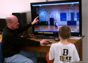 Camper receiving individual video analysis on his shooting performance